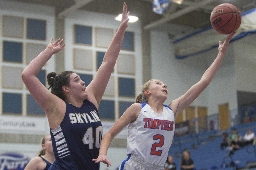 Timpview's Madelyn Boulton puts up a shot while guarded by Skyline's Cameron Mooney during Timpview's 56-49 win over Skyline in the Class 5A state semifinals at Salt Lake Community College in Taylorsville on Friday, Feb. 23, 2018.